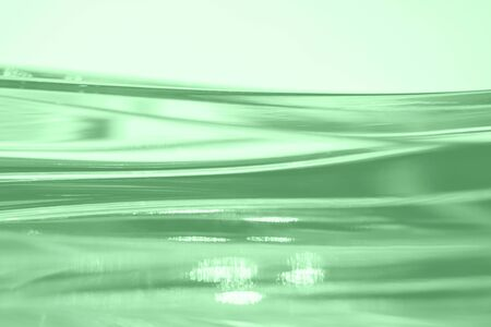 Abstract blurred soft focused futuristic wavy background. Trendy mint colored minimal backdrop. Glass texture