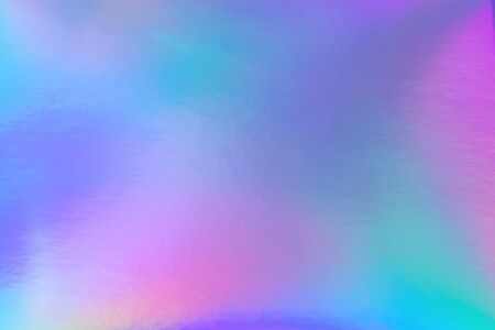 Abstract trendy rainbow holographic background in 80s style. Blurred texture in violet, pink and mint bright neon colors.