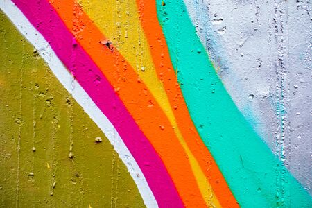 Closeup of colorful urban wall texture. Modern pattern for wallpaper design. Creative urban city background. Abstract open composition.