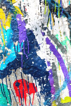 Closeup of colorful messy painted urban wall texture. Modern pattern for wallpaper design. Creative urban city background. Abstract open composition.