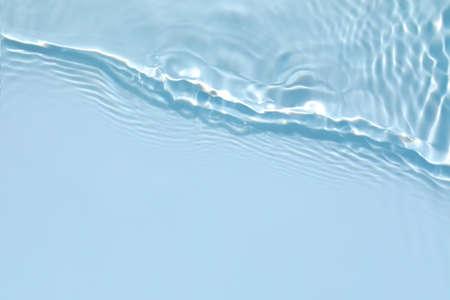 transparent blue colored clear calm water surface texture Archivio Fotografico