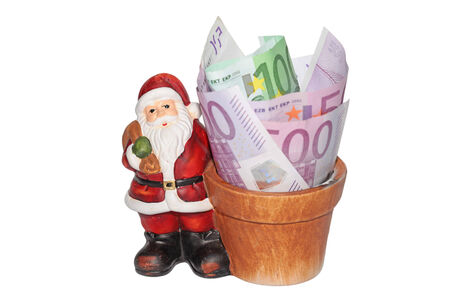 Santa claus with a bowl full of money photo