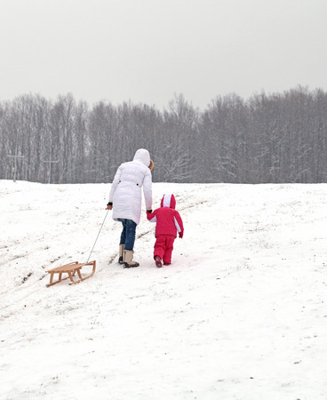 Mother and daughter sledding at winter Stock Photo - 25945533