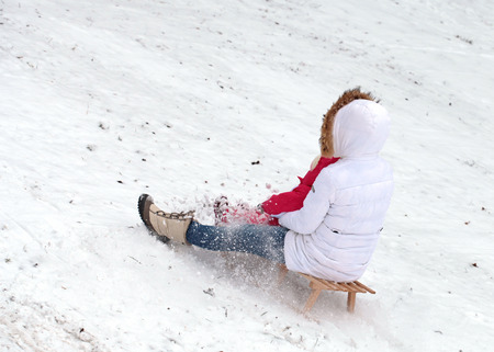 Mother and daughter sledding at winter Stock Photo - 25945542
