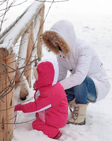 Mother and daughter on winter day photo