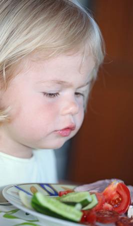 Portrait of sweet little girl having lunch