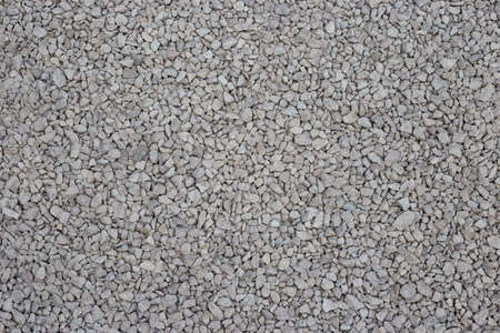 Crushed stone is a gray stone for construction, used for roads and concrete. A photo taken from a height can be used for the background.