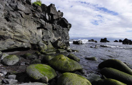 The small creek of boulders, Prainha village, Pico island, Azores photo