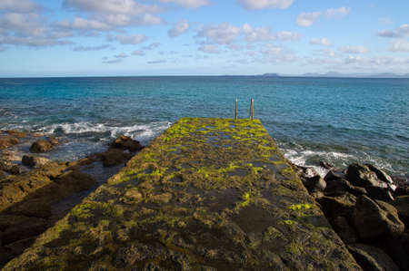 The Playa Blanca waterfronf - seaweed bridge  Lanzarote island photo