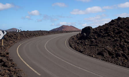 golfo: The Road to El Golfo, Lanzarote, The road spinning among the volcanoes and lava Stock Photo