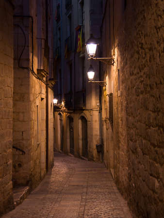 Old streets of medieval Girona by night, Catalonia,  Northern Spain photo