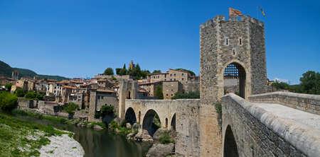 The medieval fortified bridge in Besalu, Spain  photo