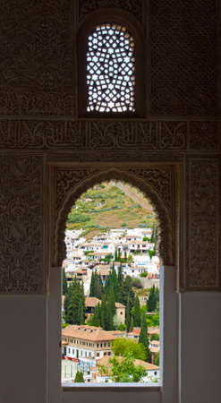 The window view from Alhambra palace, Granada city, Andalucia, Spain photo