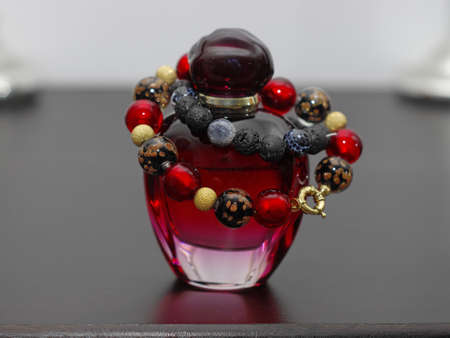 Luxurious bracelet made from Murano glass and gold on perfume bottle photo