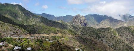 La Gomera - Roque El Cano above the town of Vallehermoso. In the background the cloudy Cumbre de Chijere with Buenavista. Stock Photo