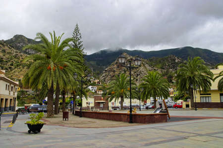 vallehermoso: VALLEHERMOSO, SPAIN - AUGUST 8, 2014: People visit main square in Vallehermoso town on August 8,La Gomera, Canary islands, Spain
