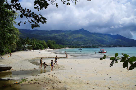beau: MAHE - AUGUST 01: Tourists and locals at Beau Vallon Beach in the west of Mahe, Seychelles on August 01, 2015.