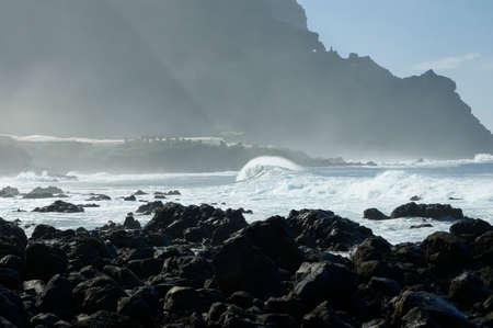 eruptive: Rocky beach with huge ocean waves on beach of Costadel Buenavista, Tenerife, Canary, Spain