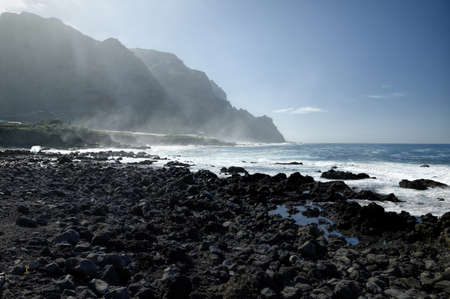 eruptive: Rocky beach with huge ocean waves on beach of Costadel Buenavista, Tenerife, Canary, Spain
