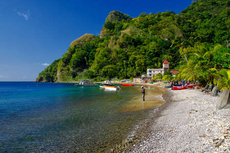 SOUFRIERE, DOMINICA - JANUARY 6, 2017 - Fishermen working on the beach in the Soufriere village on January 06, 2017. Dominica island, Lesser Antilles