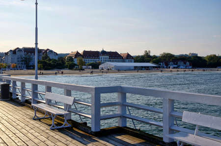 SOPOT, POLAND: SEPTEMBER 30, 2017 : View of the Sofitel Grand Hotel and beach from the wooden pier in Sopot, Poland Editorial