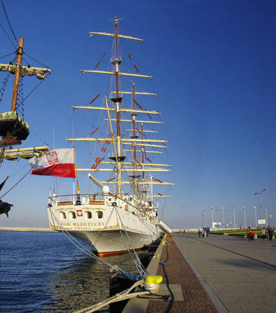 GDYNIA, POLAND: SEPTEMBER 29, 2017: STS Gift of the Youth (Dar Mlodziezy) - three-masted Polish training frigate type B-95 in Gdynia port over Baltic Sea, Poland`
