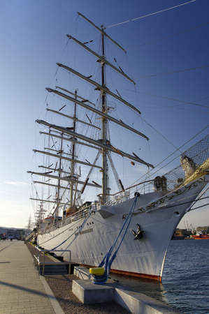 GDYNIA, POLAND: SEPTEMBER 29, 2017: STS Gift of the Youth (Dar Mlodziezy) - three-masted Polish training frigate type B-95 in Gdynia port over Baltic Sea, Poland