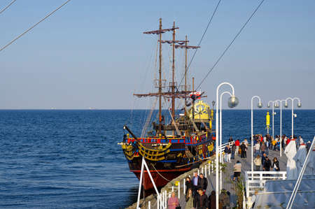 SOPOT, POLAND: SEPTEMBER 30, 2017 : The Pirate galleon docked at the wooden pier in Sopot. This is a copy of the galleon and is used for tourist trips on the sea. Editorial