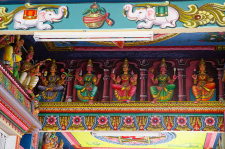 A ceiling of the ancient Hindu Temple with figures of gods and Hindu religion motifs in north of Mauritius island.