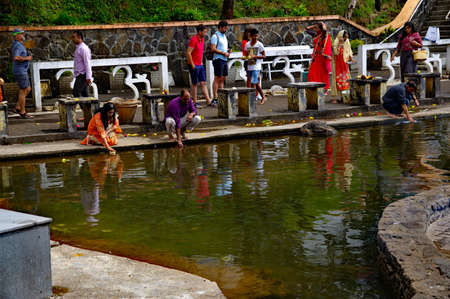 GRAND BASSIN MAURITIUS - AUGUST 18, 2018: The faithful pray at edge of Ganga Talao crater lake at Grand Bassin. It is the most sacred Hindu place in Mauritius. Editorial
