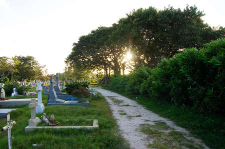 CAP MALHEUREUX / MAURITIUS - AUGUST 13, 2018: Sunset in the traditional cemetery at the coast of Cap Malheureux, Mauritius island