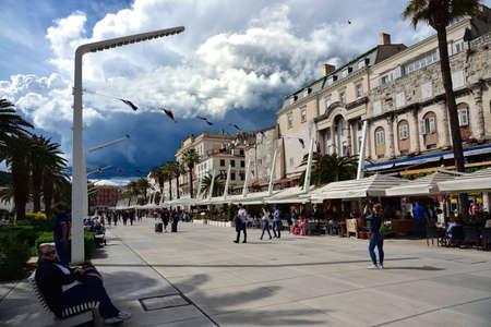 SPLIT, CROATIA - APRIL 29, 2019: People on the Splitska Riva promenade in Split on early spring day, Croatia Editorial