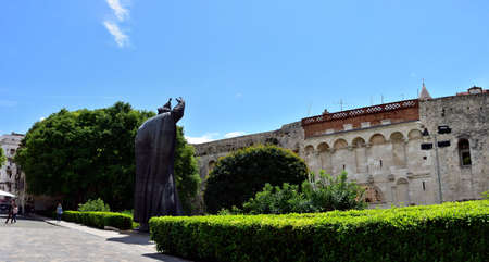 SPLIT, CROATIA - APRIL 29, 2019: Monumental bronze statue of Bishop Gregory of Nin created in 1929 by Ivan Mestrovic Stock Photo - 142978796