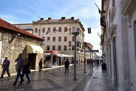 SPLIT, CROATIA - APRIL 29, 2019: A crowd of tourists walking down the main street of Marmontova in Split in early spring, Croatia