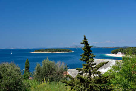 Landscape of blue Adriatic lagoon - view from the boardwalk in Promestein, Dalmatia, Croatia Stock Photo - 145079620
