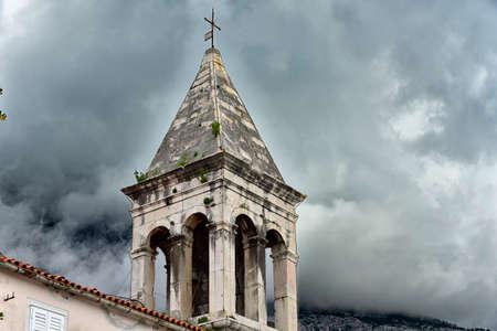 The bell tower of main church in famous and beautiful Makarska town in Dalmatia popular tourist destination in Dalmatia. Croatia
