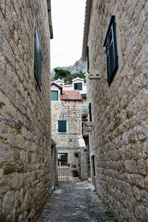 Mediterranean cozy deserted stone walk street in Dalmatia, Omis, Croatia, Europe Stock Photo