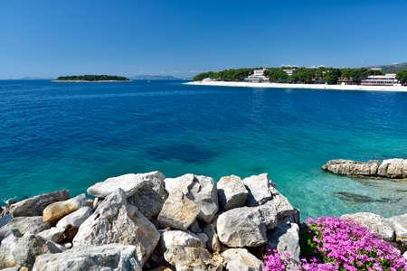 The snow white beach in famous and beautiful Primosten town in Dalmatia - popular tourist destination in Dalmatia. Croatia