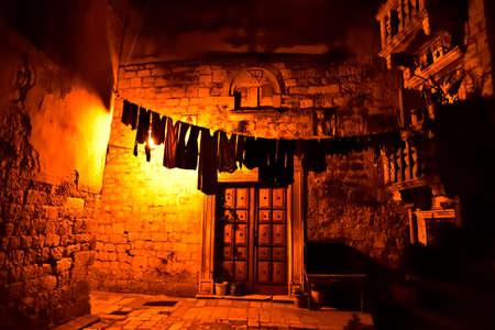 Narrow streets of mediterranean city. Trogir at night. Croatia.