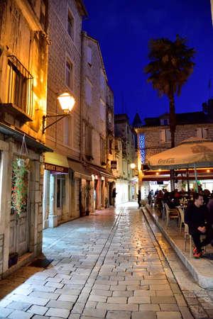 TROGIR, CROATIA - APRIL 31, 2019: Restaurant in narrow streets of mediterranean city. Trogir at night. Croatia.`
