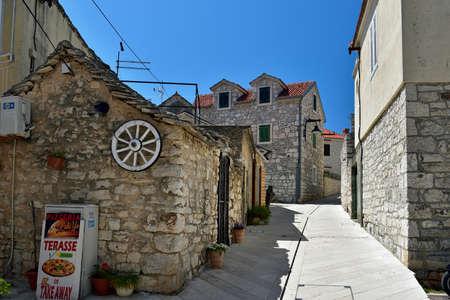 PRIMOSTEN, CROATIA - MAY 2, 2019 - The deserted street in famous and beautiful Primosten town in Dalmatia - popular tourist destination in Dalmatia. Croatia