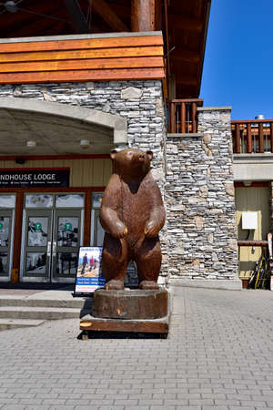WHISTLER, BC, CANADA, MAY 30, 2019: Bear statue in front of Roundhouse Lodge building in the Ski Resort in Whistler Editorial