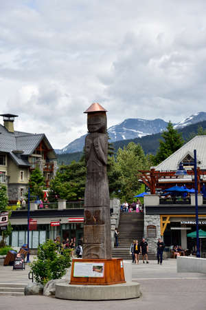 WHISTLER, BRITISH COLUMBIA, CANADA, MAY 30, 2019: The Indian totem poles located in center of Whistler - Canadian resort town located approximately 125 kilometers north of Vancouver