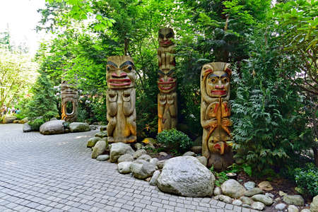 VANCOUVER, BRITISH COLUMBIA, CANADA, MAY 31, 2019: The Indian totem poles located in Capilano Park in Vancouver, Vancouver, BC. Canada