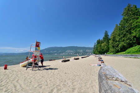 VANCOUVER, BRITISH COLUMBIA, CANADA, MAY 31, 2019: Third beach along Stanley Park in Vancouver, Canada. View of the North Shore