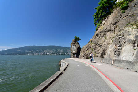 VANCOUVER, BRITISH COLUMBIA, CANADA, MAY 31, 2019: Siwash Rock, a famous rock outcropping in Vancouver