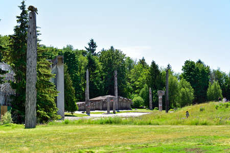 VANCOUVER, BC, CANADA, JUNE 03, 2019: First Nations totem poles and Haida houses in Museum of Anthropology at the University of British Columbia UBC campus in Vancouver