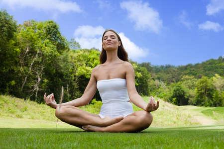 pranayama: Quiet young woman practicing yogas pranayama