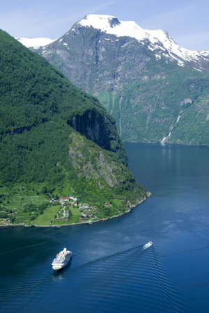 Geiranger fjord from the top of the mountain, ships, snow
