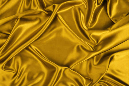 Oro de seda, hilo, textura, color de la riqueza, el glamour